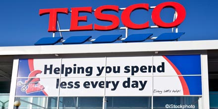 Tesco slashes dividend and rushes in new boss