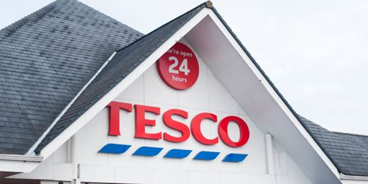 Tesco soars on Booker deal and dividend pledge