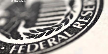 Fed points to Q1 2015 rate rise with QE end date