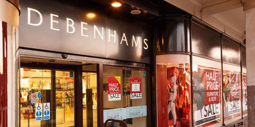 Retail woes: UK sales slump as Debenhams halves dividend